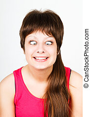cross eyed squinting expression girl - cross eyed squinting...