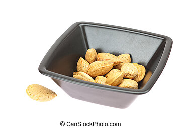 almonds in a bowl isolated on white