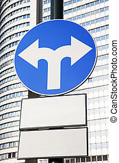 Traffic Sign in Urban Setting - Traffic Sign with Two Arrows...