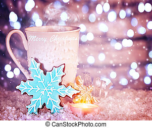 Christmas coffee - White cup of coffee with blue snowflake...
