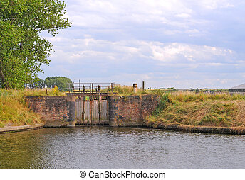 Ancient sluice in Flanders - Ancient sluice on canal in the...