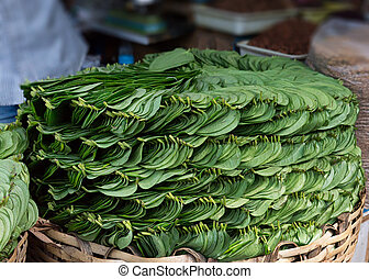 Stack of Betel leaves (Piper Betle) in old town Bangalore. -...