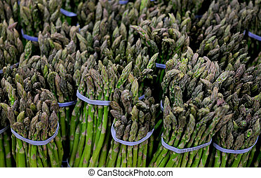 asparagus bunches -  a lot of asparagus bunches  in market