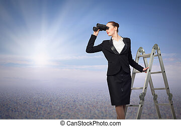 businesswoman looking through binoculars - businesswoman...