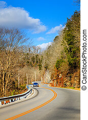 Winding road in Kentucky - Two lane road curving through the...
