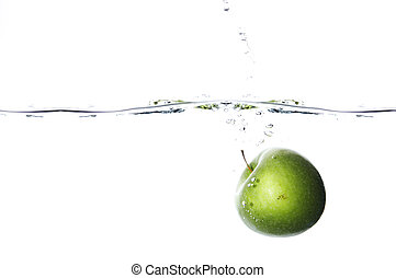 drowning apple - Apple dropped to water on white background