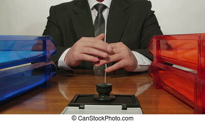 Businessman hands waiting for paperwork at the desk in...