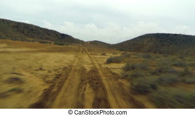 Desert Dirt Road - Driving on a dirt road in a desolate...