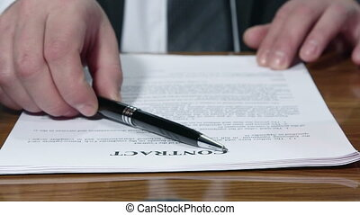 Businessman signing a contract - Businessman signing and...