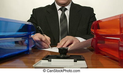 Office worker signing some documents