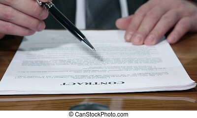 Businessman signing a contract close-up