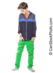 sensitive male teenager with hands in his pockets, isolated on white.