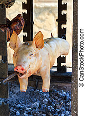 Grilled pig - Pig being traditionally prepared on the...