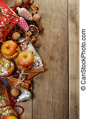 Christmas background of homemade oven baked apples, spices,...