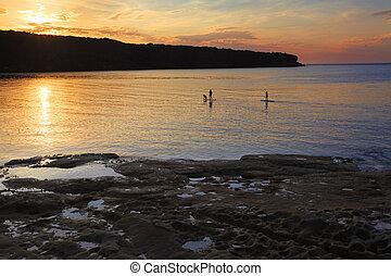 Paddle boarding on Botany Bay at sunrise