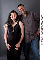 Happy East Indian Husband with his Pregnant wife