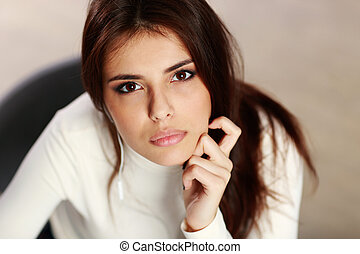 Closeup portrait of a young thoughtful woman