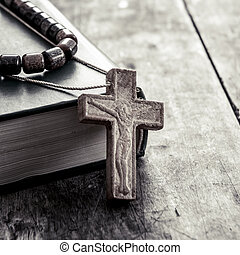 cross on a wooden surface closeup - wooden cross on a wooden...