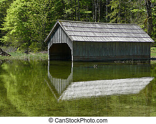 wood boat-house on a lake side