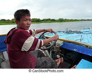 Boat boy - TONLE SAP LAKE, CAMBODIA - CIRCA OCT 2008 : A...
