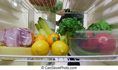 food from the fridge time-lapse - Woman takes out food from...