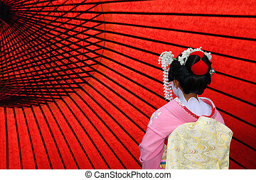 The back view of a Japanese Geisha, copy space