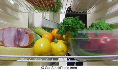 vegetables from the fridge - Female hand takes out meat and...