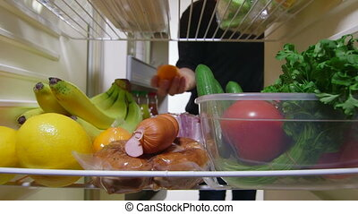 Whats inside my fridge - Family members taking food from the...