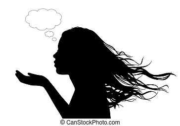 woman sending a flowing kiss - profile of a young beautiful...