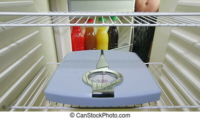 Weight loss and diet - Fat man looking for food in an empty...