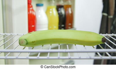 Weight loss diet menu - Fat man takes out banana from an...