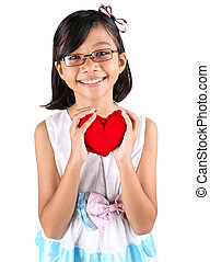 Young Girl Valentine - Young Malay Asian girl holding a...