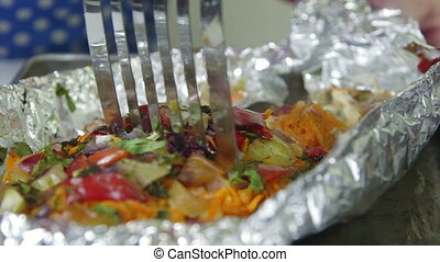 Baked Fish In Foil - Fresh baked salmon fish cooking in the...