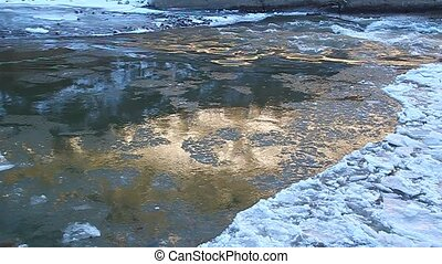 Floe floating on the river, illumin