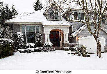 Snow for the Holidays - Photo of front yard of home during...