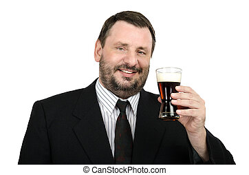 Mature man with glass of ale - Mature man in suit with glass...