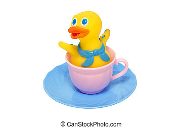 Cup and saucer toy rubber duck. Isolated....