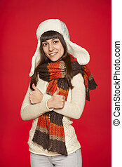 Winter girl showing thumbs up - Winter girl in hat and...