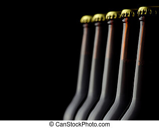 Beer bottles - Close up bottles of beer on a black...