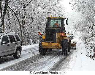 heavy snowing - Cars wait for road to be opened by snowplow