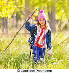 Hiking kid girl with backpack in autum poplar forest -...