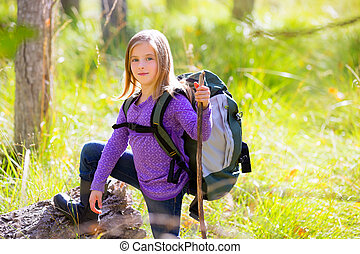 Hiking kid girl with backpack in autumn poplar forest -...
