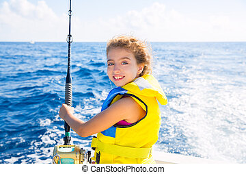 kid girl boat fishing trolling rod reel and yellow life jacket