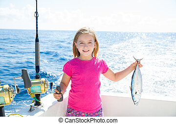 Blond kid girl fishing tuna little tunny happy with catch -...