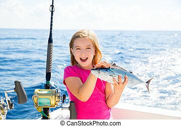 Blond kid girl fishing tuna bonito sarda fish happy catch -...