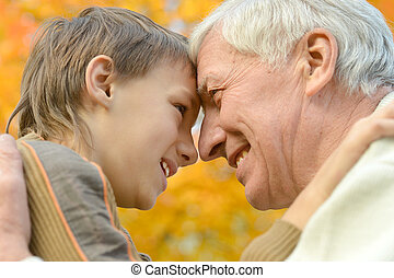 Old man with grandson - Portrait of a grandfather with child...