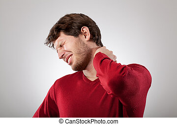 Neck pain - Man isolated has a strong neck pain
