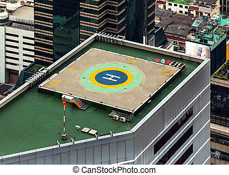 Helipad (Helicopter landing pad) on roof top building. -...