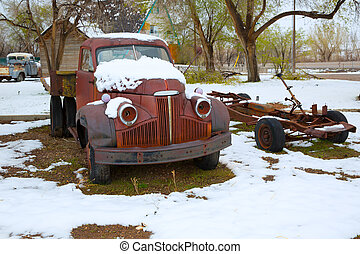 Snow old truck in the early spring time in Nevada - Snow...