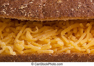 Sandwich with shredded cheese
